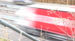 Motorway traffic  vehicles are blurred giving the impression of speed Stock Footage