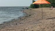 Orange beach umbrella Stock Footage