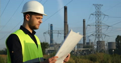 Transformer Station Young Worker Man Reading Energy Generator Diagram Projection Stock Footage