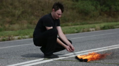 The fire eater, performs the trick Stock Footage