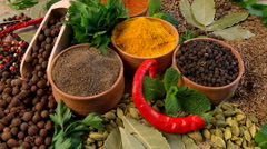 Spices in wooden bowls. The rotation of the composition of a mixture of spice Stock Footage