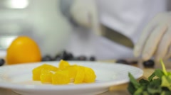 Chef preparing fresh fruit salad Stock Footage