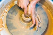 Pottering - creating a clay cup in process Stock Photos
