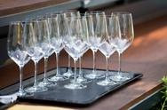 Wine glasses on the table in the restaurant Stock Photos