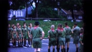 1966: boy scout troop in parking lot with man taking pictures of other scouts. Stock Footage