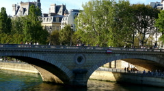 Paris, France. Pedestrians crossing a bridge over the River Seine. Stock Footage