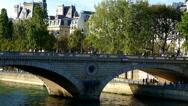 Paris, France. Pedestrians crossing a bridge over the River Seine. Stock Footage
