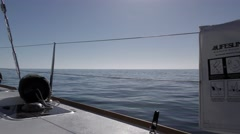 Starboard view in the middle of the endless Pacific Ocean on a calm day Stock Footage