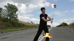 The fire eater, the rotation of fireballs Stock Footage