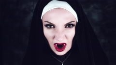 4k Halloween Shot of a Horror Nun Showing Bloody Vampire Teeth Stock Footage