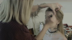Makeup artist preparing bride before the wedding in a morning Stock Footage