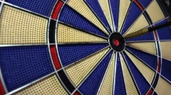 A close shot of a dart board and a person hitting the bulls eye Stock Footage
