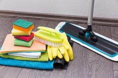 House cleaning equipment and accessories on the laminate floor Stock Photos