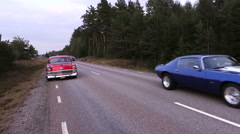 American muscle become roadside stands and are overtaken by several muscle cars Stock Footage
