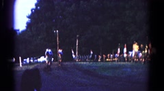 1966: people in various costumes marching through the street in a parade Stock Footage
