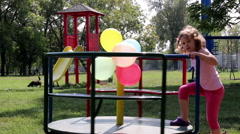 Little Girl On A Merry Go Round Playground Stock Footage