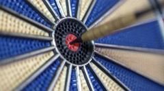 4K close-up footage of a dart board and a person hitting the bulls eye Stock Footage