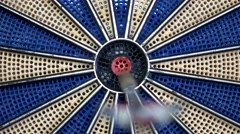 Front shot of a dart board and a person hitting the bulls eye Stock Footage