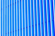 Detail of blue striped metal facade for background Stock Photos
