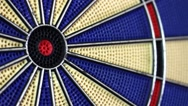 Close-up shot of a dart board and a person misses the inner bulls eye Stock Footage