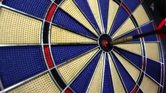 Footage of a dart board coming in and goes out of focus Stock Footage