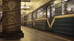 Russian metro subway trains leaves beautiful soviet Avtovo station in Saint Pete Stock Footage