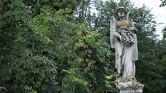 Beautiful statue of angel at the old cemetery Stock Footage