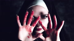 4k Halloween Shot of a Horror Nun Showing Bloody Hands Stock Footage