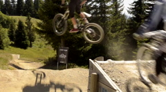 Mountain bikers on single track trail Stock Footage