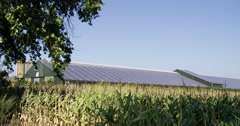 Solar pv panels on farm roof with corn Stock Footage