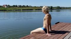 Blonde Man Sitting on the Wooden Bridge. Freedom. Stock Footage