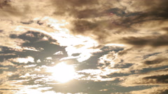 Dramatic storm clouds moving rapidly across the sky, covering the sun. Stock Footage