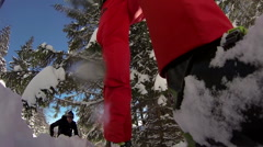 POV from front of ski of two people cross-country skiing in snow covered mountai Stock Footage