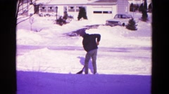 1966: on heavy winter snowfall snow clearing from young boy HAGERSTOWN, MARYLAND Stock Footage