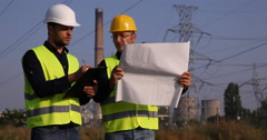 Electric Tower Worker Men Talking About Energy Generator Maintenance Schedule Stock Footage
