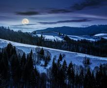 Mountainous area on winter at night Stock Photos