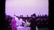 1966: a woman in pink outside shaking hands with graduates HAGERSTOWN, MARYLAND Stock Footage
