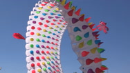 Bright colorful kites on the beach Stock Footage