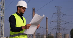 Young Electricity Engineer Man Checking Transformer Station Technology Designs Arkistovideo