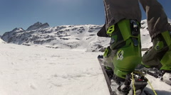 POV from behind boot/ski of speed riding flying down a mountain. Stock Footage