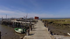 Walking in old wooden fishing port low tide carrasqueira portugal steady shot 4k Stock Footage