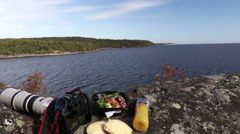 A photographer will have lunch with a view of the Swedish archipelago Stock Footage
