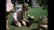 1964: girls at play in the garden on a sunny day with the dog HAWAII Stock Footage