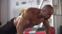 Man doing clapping push-ups and CrossFit workout at the gym. Stock Footage