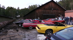 Many American muscle cars at a car meet in Sweden Arkistovideo