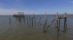 Old wooden fishing port with low tide carrasqueira portugal steady shot 4k Stock Footage