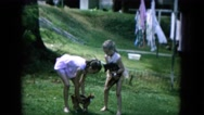 1964: siblings are seen on a table posing HAWAII Stock Footage