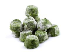 Frozen spinach close-up Stock Photos