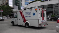 Vancouver Emergency Medical Ambulance Flashing Lights Parked In The Downtown Stock Footage