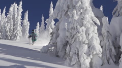 A man skiing down a snow-covered mountain in the winter. Stock Footage